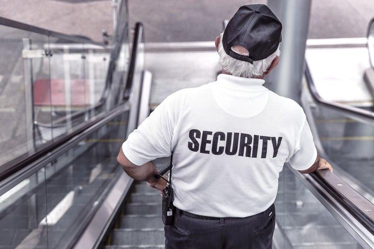 security-guard-on-escalator