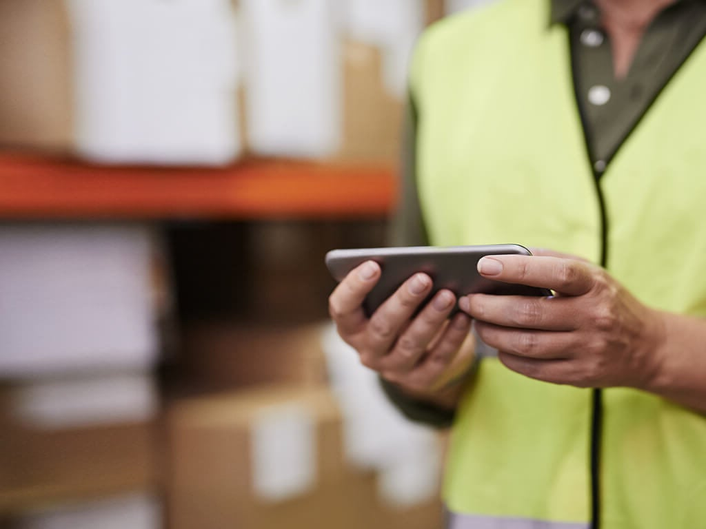 Warehouse worker with mobile