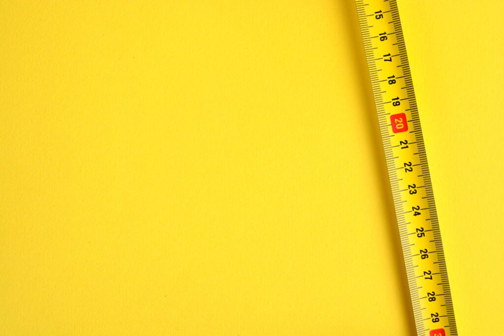 Tape measure scale on a yellow background.