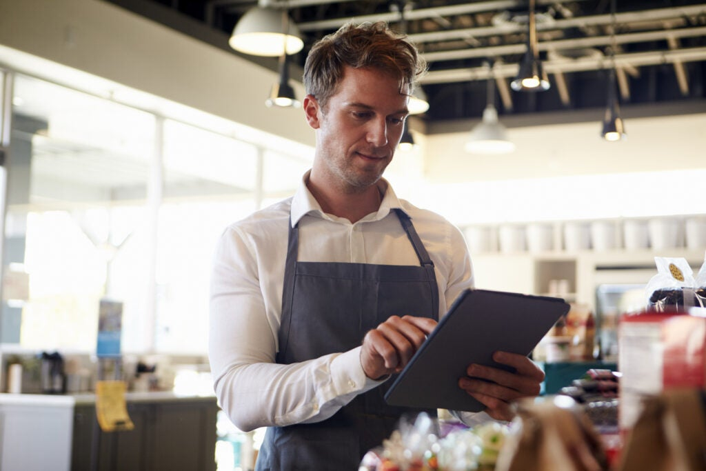 Employee Checking Stock With Digital Tablet