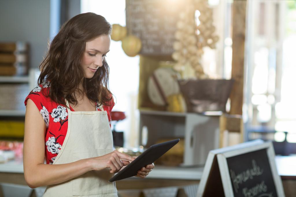 Retail associate holding ipad